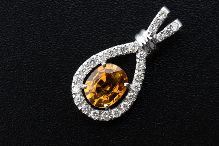 topaz and Silver diamond pendant on black background Stock Photo