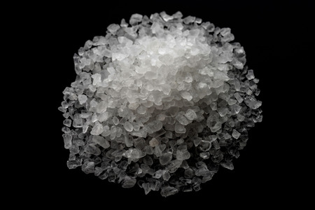 white crystals sea salt on black background, top view Stock Photo