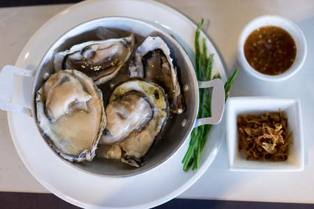 oysters on garnish with sauce Stock Photo