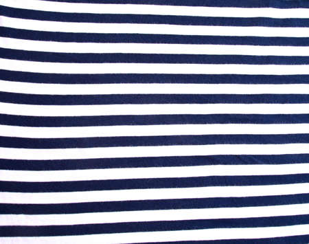 Detail of blue and white sailors shirt before packing into a suitcase. photo