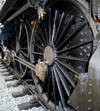 iron hoops: Detail of large wheels historic locomotives at the railway museum.