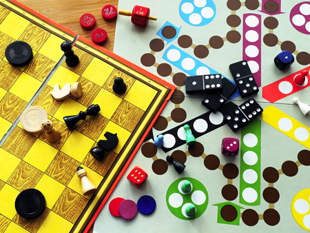 chess game: Board games are carelessly strewn across the table.