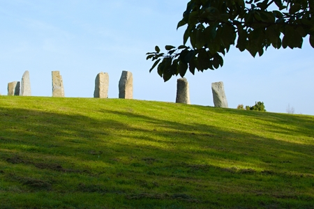 monolithic: A group of large monolithic stones on meadow in dendrologic garden  Stock Photo