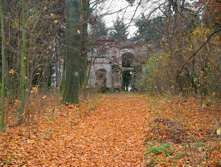 Ruins of old aristocratic summer house in the autumn forest. Stock Photo
