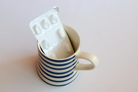 plato: Opened plato regularly used drugs in the blue striped mug.