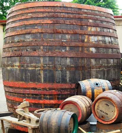 iron hoops: One large and a few small barrels for beer at the brewery courtyard.