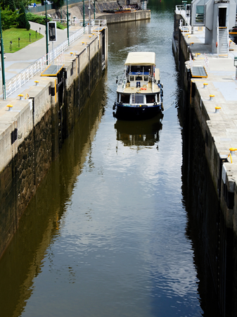 heaving: Sluice on the river in Prague heaving a small boat. Stock Photo