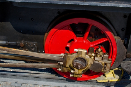 connecting rod: Red bike from the historic locomotive with interesting mechanical transmission rods.