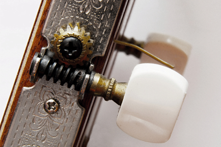 spanish guitar: Detail of an old drive with the Spanish guitar that tunes the instrument.
