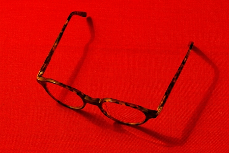 annealed: Brown annealed glasses on a table with a red tablecloth.