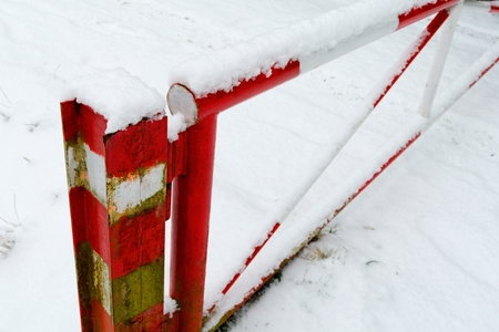 iron bars: Red and white barrier with snow this years first snow.