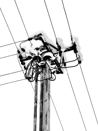stanchion: Power pole, which is the snow last spring and heavy wet snow. Stock Photo