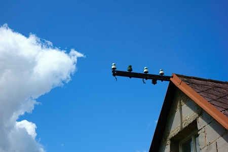 house detail on a background of blue sky which is without