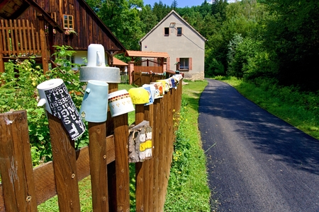 Mugs on the fence of the fence near the village, used as a summer cottage.