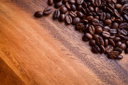 coffeetree: coffee beans on wood background