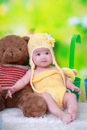 babygirl: Cute little girl sitting on the little bear