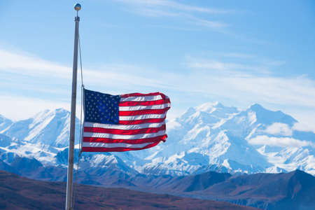 denali: usa flag with mount mckinley in background, denali national park