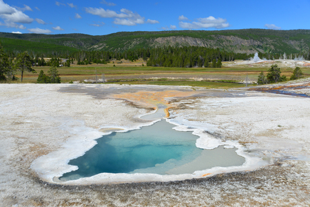 faithful: Hot geyser pool in Old Faithful area of Yellowstone National Park