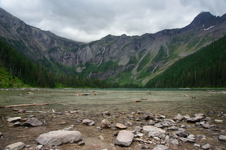 Glacier National Park: wide angle of Avalanche lake in cloudy day, Glacier National park, Montana Stock Photo