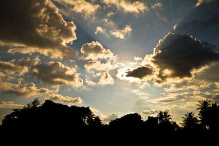 nightfall: Dark clouds covering the sun in the sky