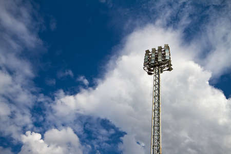 Spot-light tower in blue sky with cloud  photo
