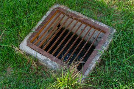 Stock Photo   The Steel Floor Drain, Running Water From The Meadow In Garden