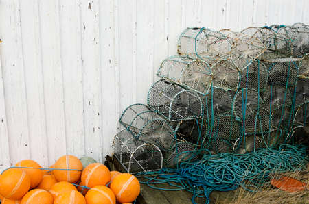 lobster pots: Lobster pots against a wall waiting to be used