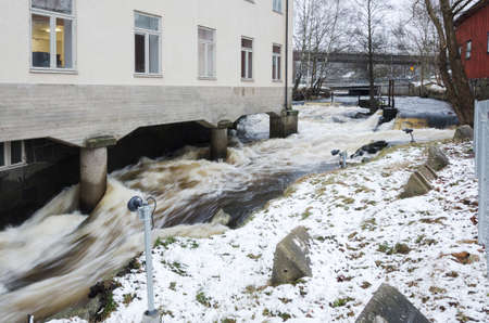 rushing water: Rushing water below the old house and down to the city Stock Photo