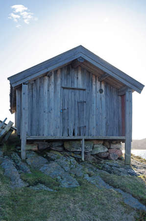 boathouse: one old boathouse made of wood standing in Bohuslan Sweden