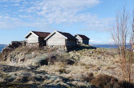 horizontals: Three old boat House on the westcoast in sweden
