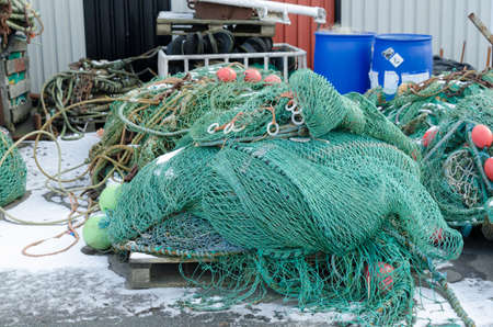 fishingnet: professional fishing net in the harbour ready to go out with the boat and catch the fish