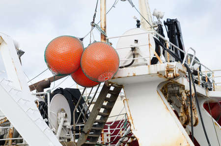three big float on big fishingboat mark where the net is in the sea