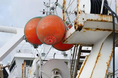 fishingboat: three big float on big fishingboat mark where the net is in the sea