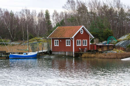 fishermans boathouse and boat with pier waiting to go out and fish