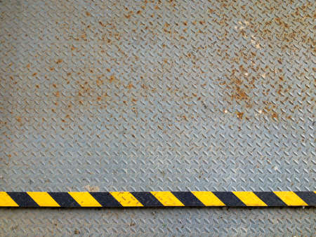 checker plate: steel background with rust, old checker plate with rust, warning tape