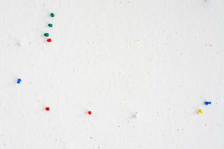 pin board: old White board with various color of pins. Stock Photo