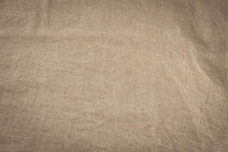 earth tone: old textile background with earth tone, sepia