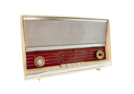 old and vintage radio on white background photo