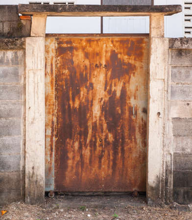 sliding door: old metal sliding door with rusty, at a fence