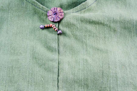 calico: old green calico textile with wood button