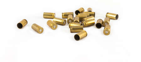 casings: old 9 mm.  ammunition shell on white background