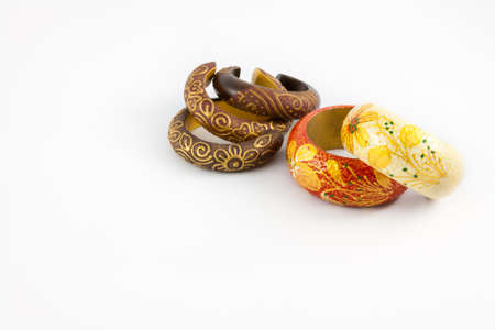circlet: wooded vintage bracelets with flower pattern on white background