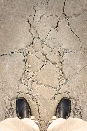 a man standing on crack ground, for risk concept