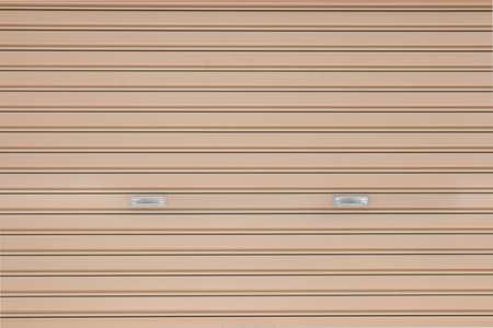 shutter door: brown metal shutter door with handle, background