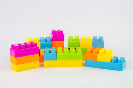 building bricks: Small pile of colorful childrens building bricks on white background