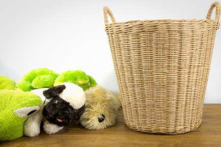 woo: animal dolls beside  rattan basket on wood  floor Stock Photo