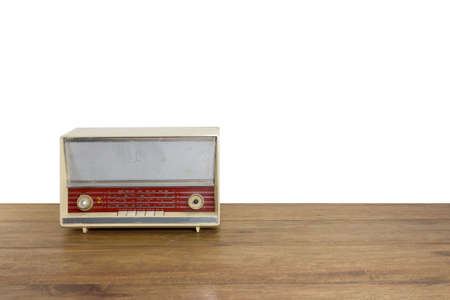 electronic background: old and vintage radio on wood floor, isolate on white wall  background Stock Photo