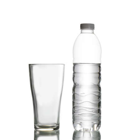 water bottle: bottle of water and empty glass isolated on white background, clipping path