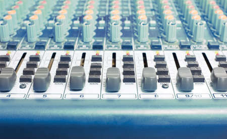 control panel lights: old and dirty sound mixer with blue tone