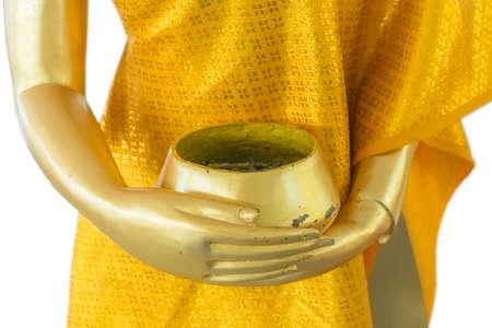 limosna: estatua del monje de oro con bol de limosnas